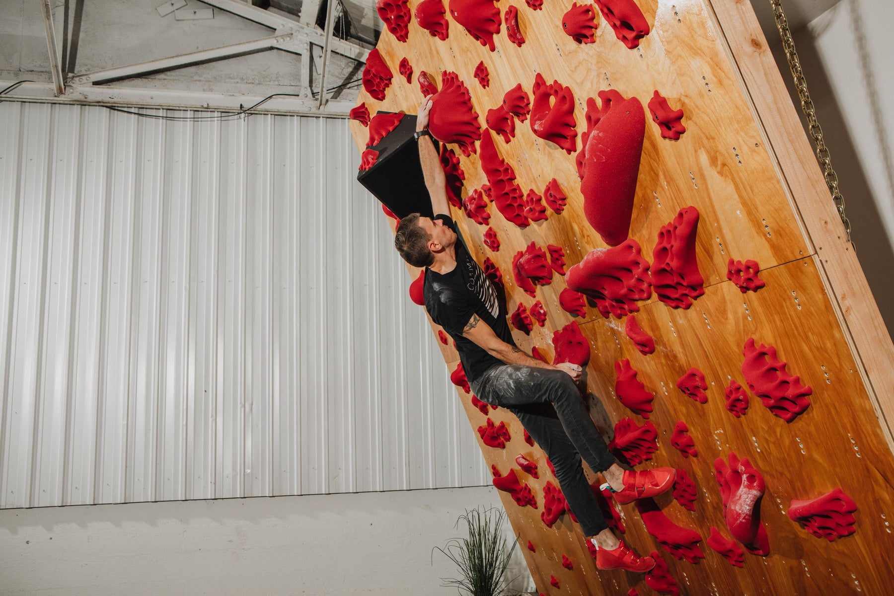 topo x so ill collaboration climbing shoes are being climbed in at the so ill warehouse wall
