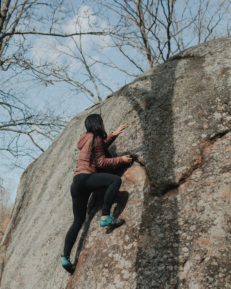 a woman climbs at Elephant Roacks in the REI So iLL collaboration rock climbing shoe the main street lv