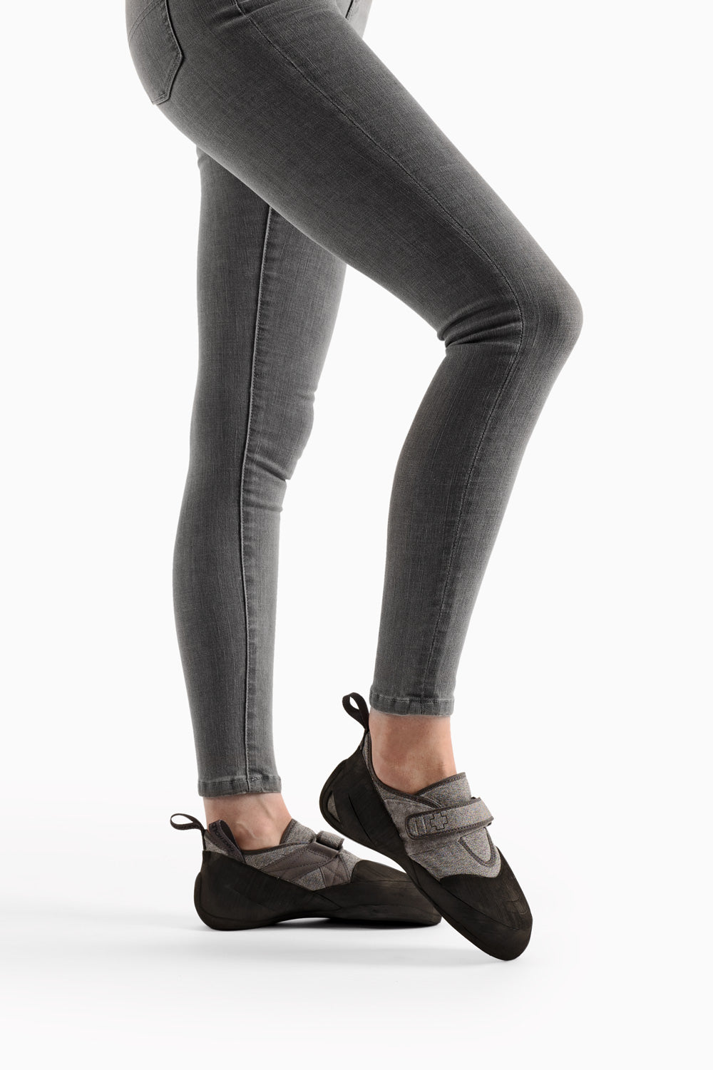 so ill women's denim in smoke washout color on a model in front of a grey background
