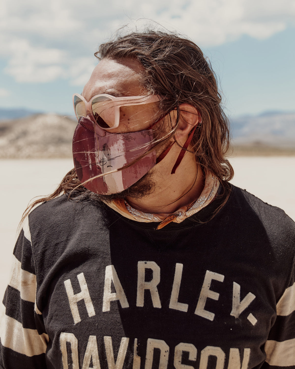 jason momoa collaboration on the roam x so ill face mask in camo color with the on the roam logo displayed.