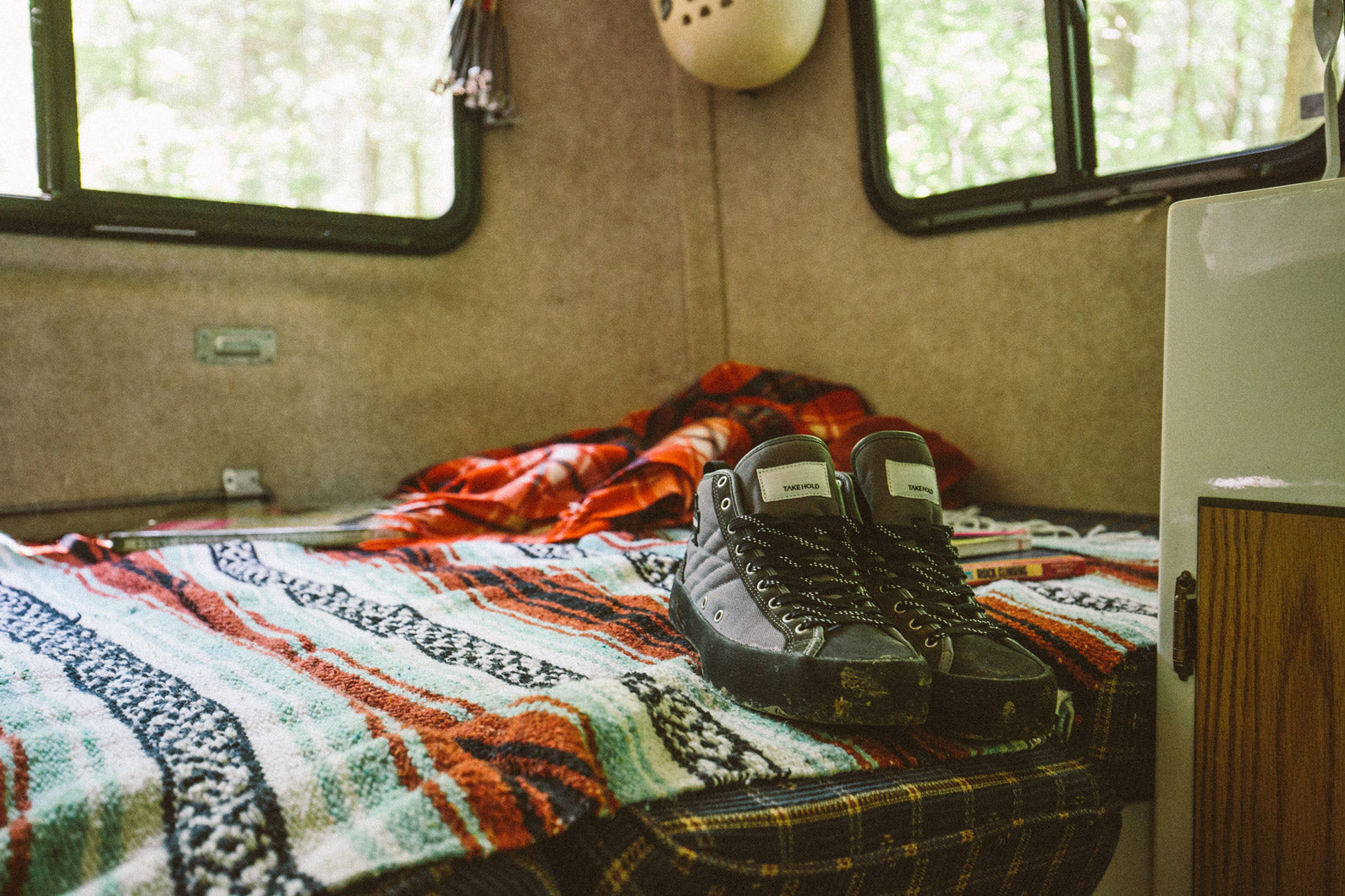 So iLL Approach Shoe resting on camper bed