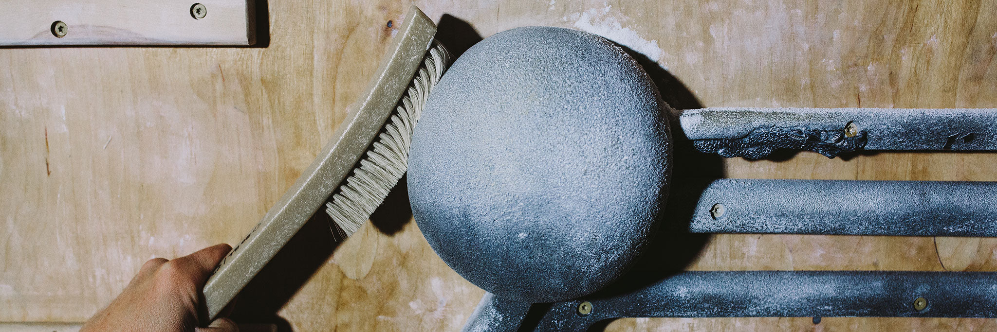 Sloper Brush being used to clean hang board