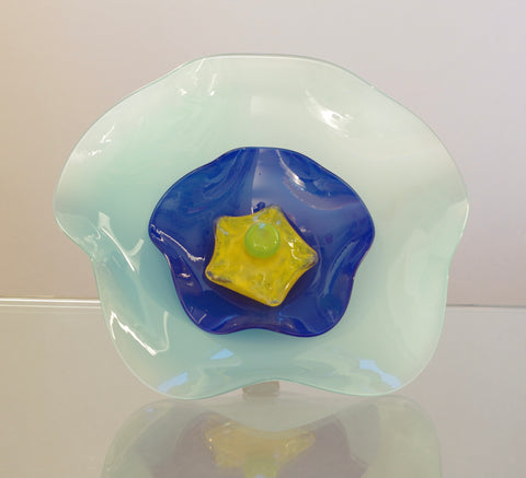 Large Light Blue Flower with Dark Blue, yellow and green Centres