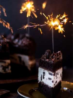 Cookies & cream black cocoa cake with a lit sparkler on top