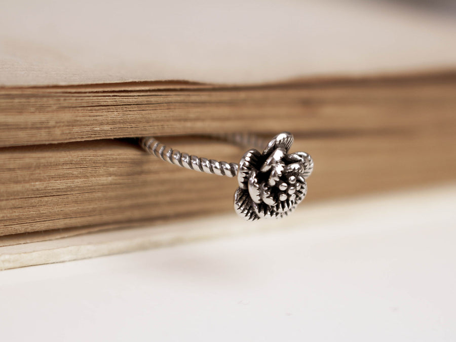 silver ring rose form