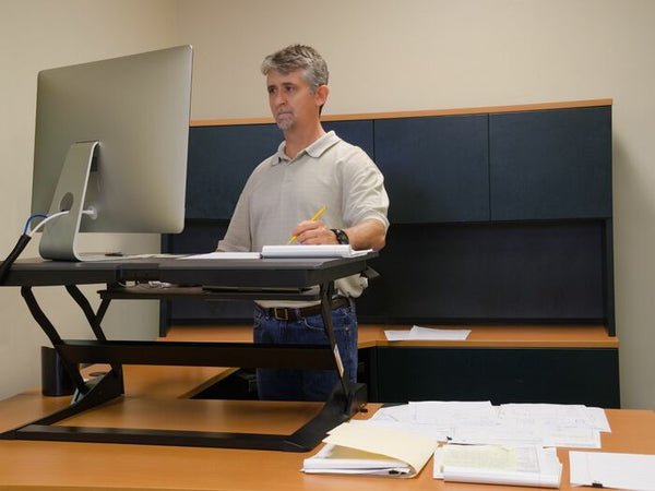 man using a standing desk