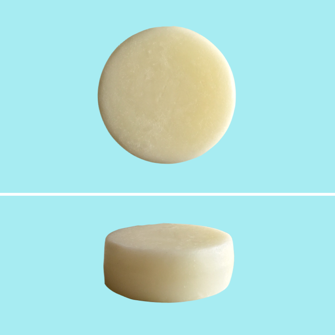 Top and side view of Green Ablutions Purifying Peppermint Conditioner Bar on blue background. Sustainable Zero-waste Plastic-free haircare.