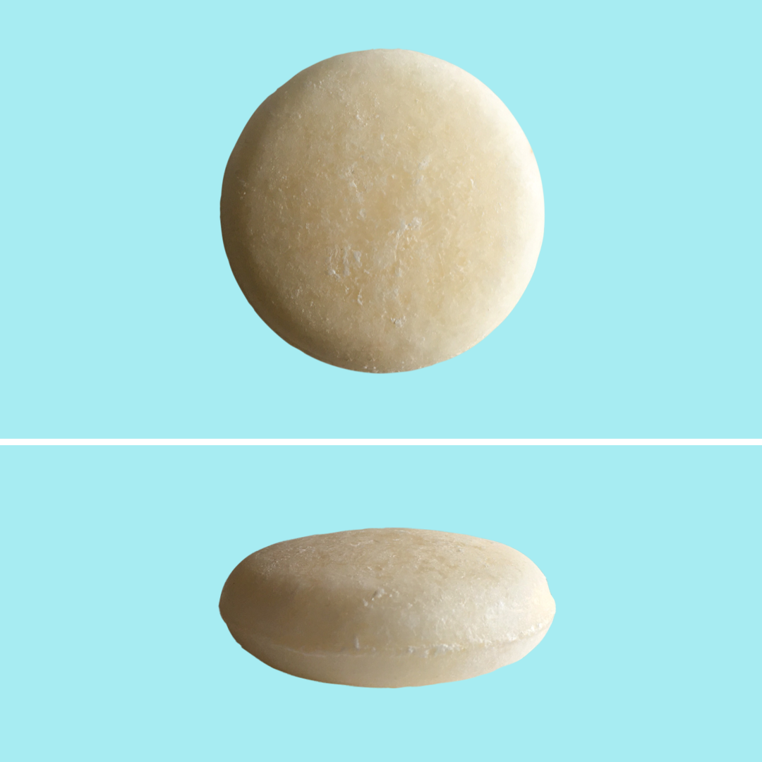 Top and side view of Green Ablutions Purifying Peppermint Shampoo Bar on blue background. Sustainable Zero-waste Plastic-free haircare.