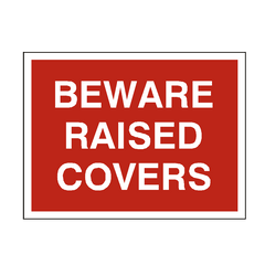 Beware Raised Covers Sign