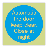 Automatic Fire Door Keep Clear Close At Night Photoluminescent Sign | PVC Safety Signs