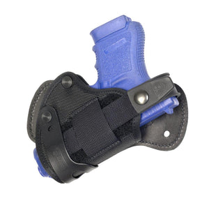 Advanced Back Holster with adjustable tension and a reversible retention strap.