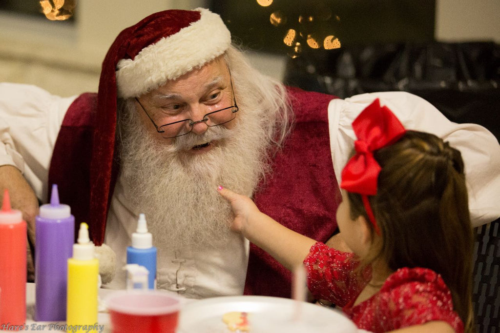 A Tug on Santa's Beard while Decorating Cookies at Brungot Farms Magical Evening with Santa