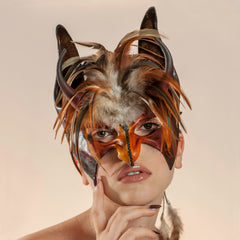 New York maskmaker Wendy Drolma. Gallery for beautiful leather masks and headdresses.