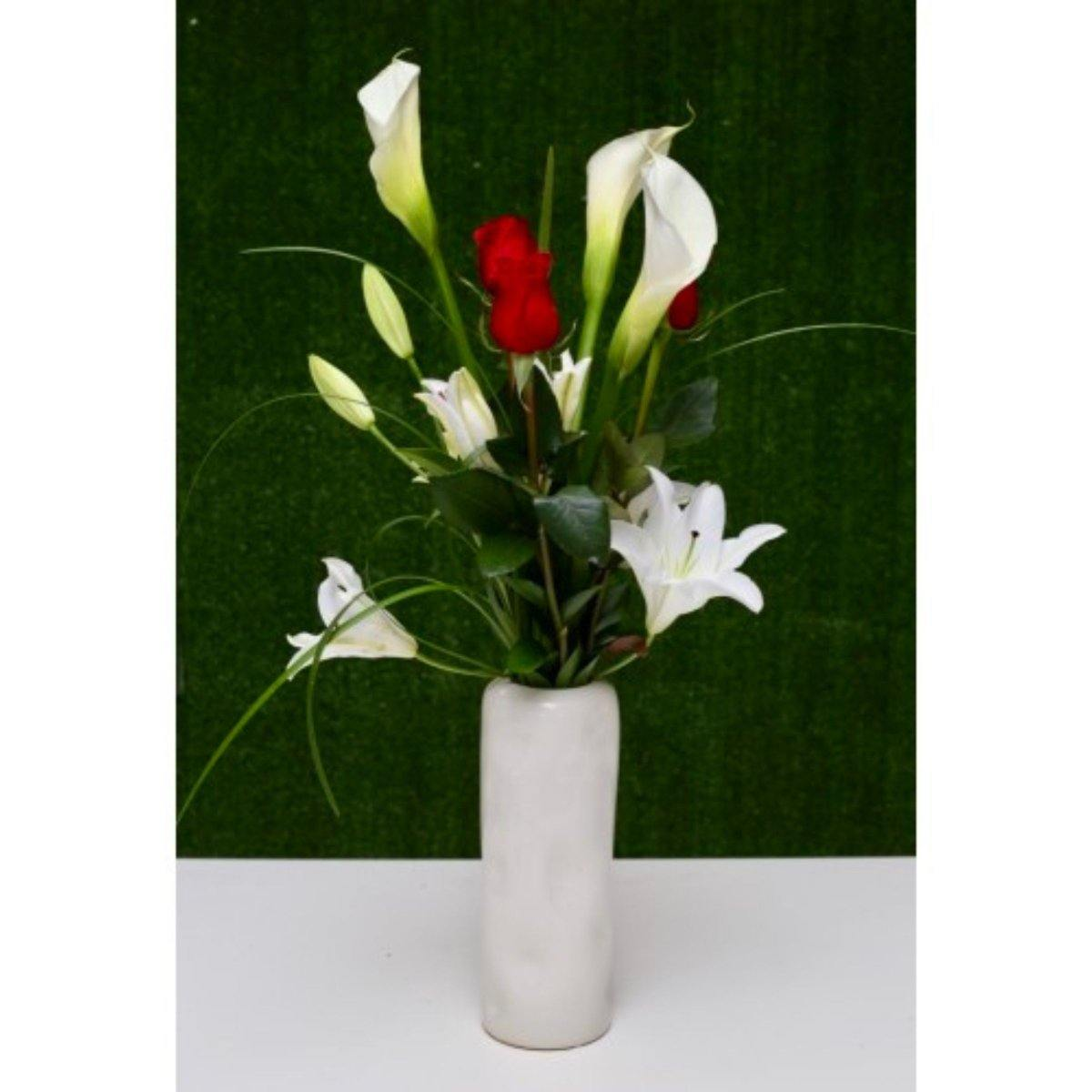 Elegant Floral Wonder in a Ceramic Vase - Shalimar Flower Shop