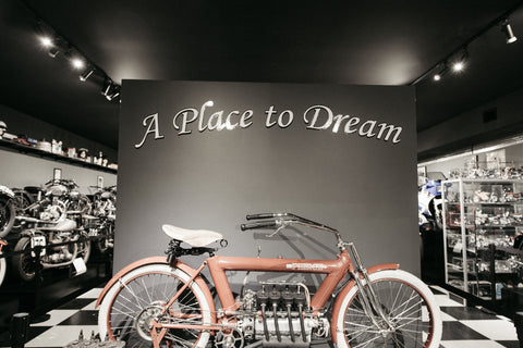 "Bike in front of wall that says ""A place to dream"""