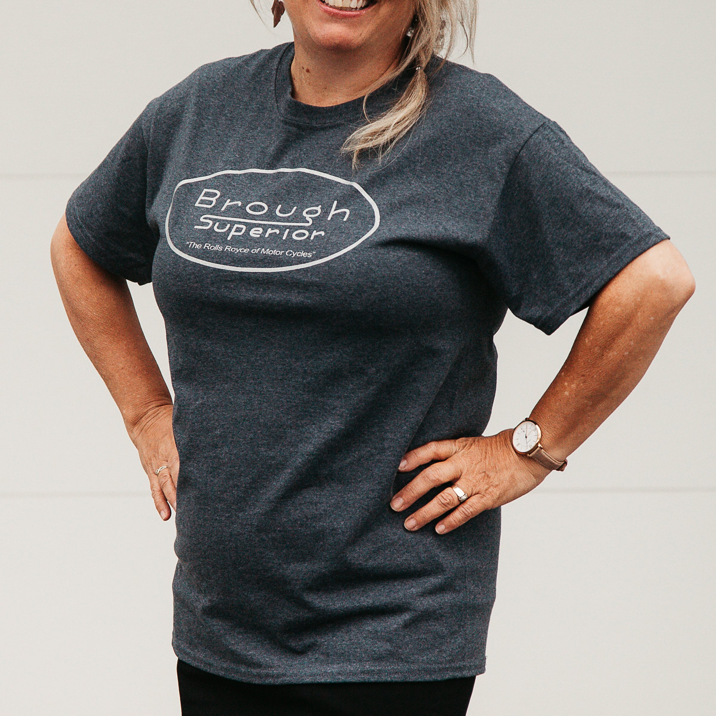 "Dreamcycle Motorcycle Museum |  Closeup of woman wearing tshirt in lifestyle environment with text ""Brough Superior""."
