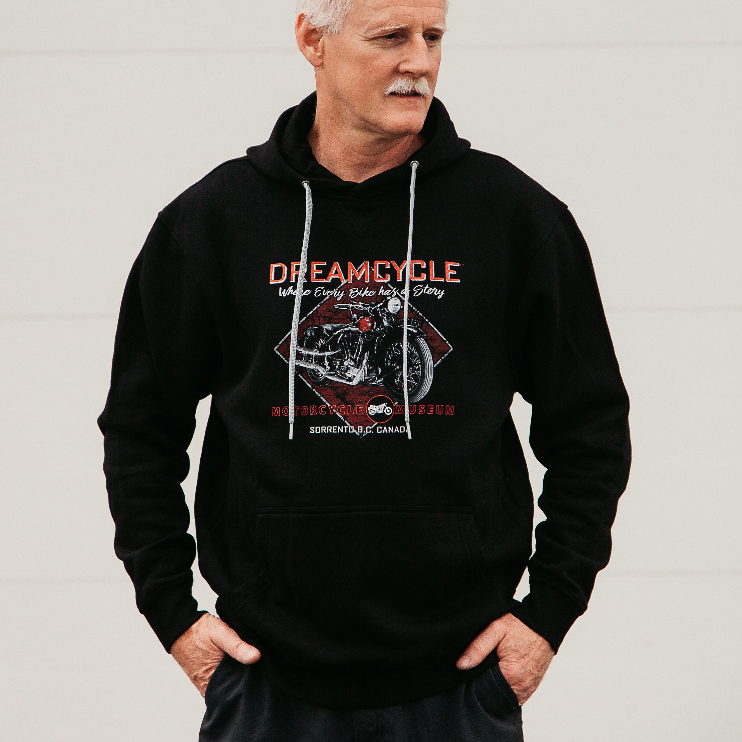 Dreamcycle Motorcycle Museum |  Male modelling dreamcycle hoodie in lifestyle environment.