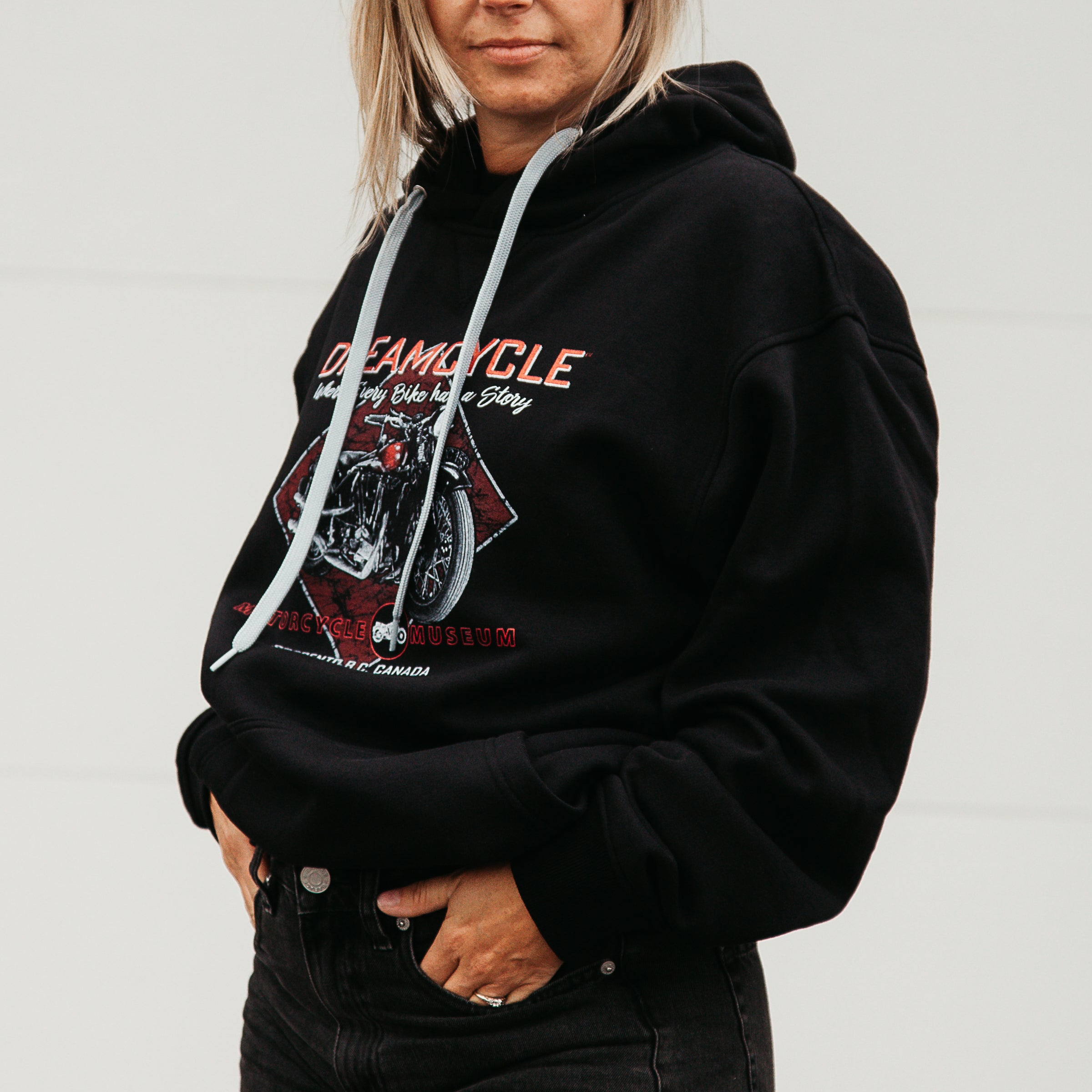 Dreamcycle Motorcycle Museum |  Female modeling black dreamcycle hoodie in a lifestyle environment.