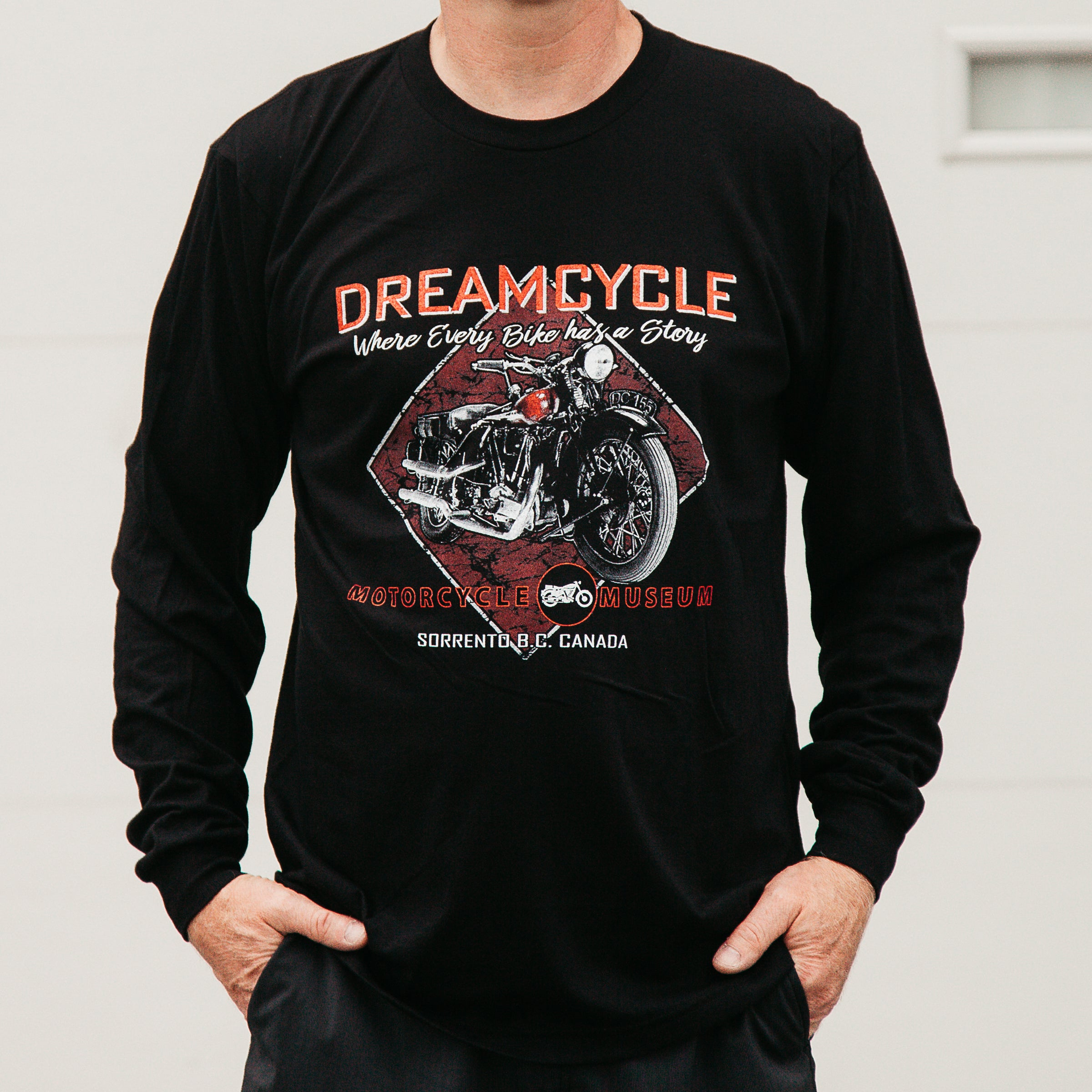 Dreamcycle Motorcycle Museum |  Closeup Longsleve dreamcycle shirt on model in lifestle setting.