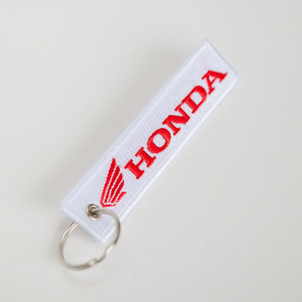 Dreamcycle Motorcycle Museum |  White honda keychain on white background.
