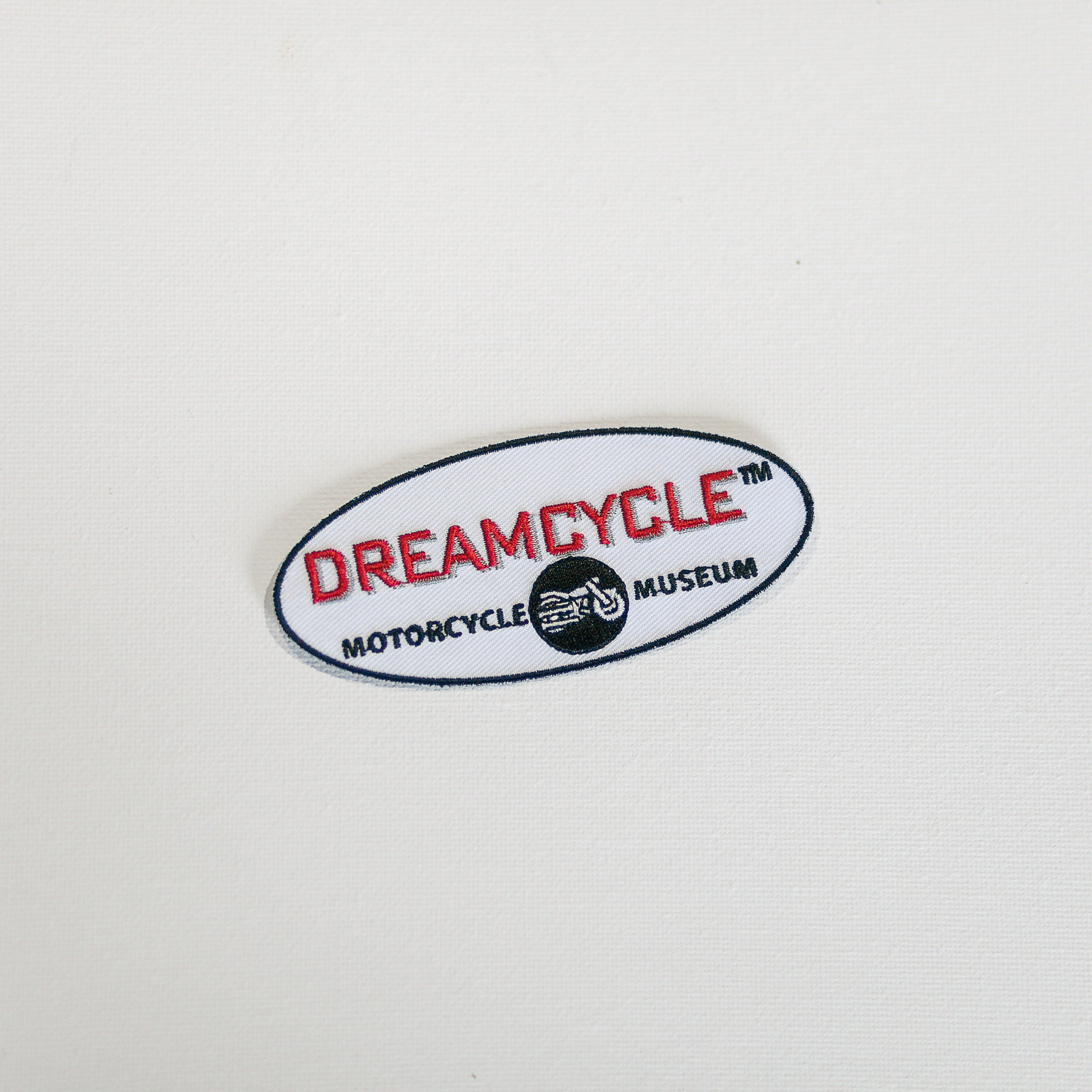 Dreamcycle Motorcycle Museum |  Dreamcycle patch on white background.