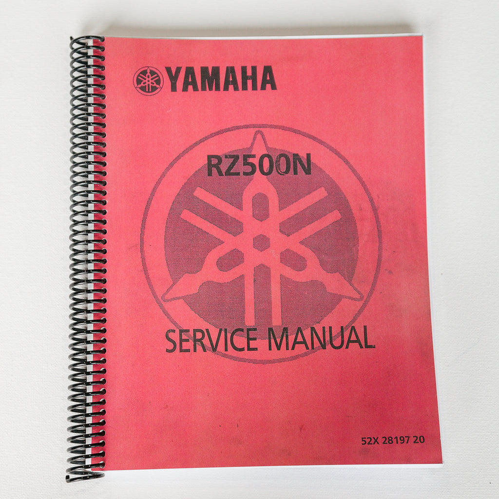 Dreamcycle Motorcycle Museum |  Yamaha RZ500N Service manual on white background.