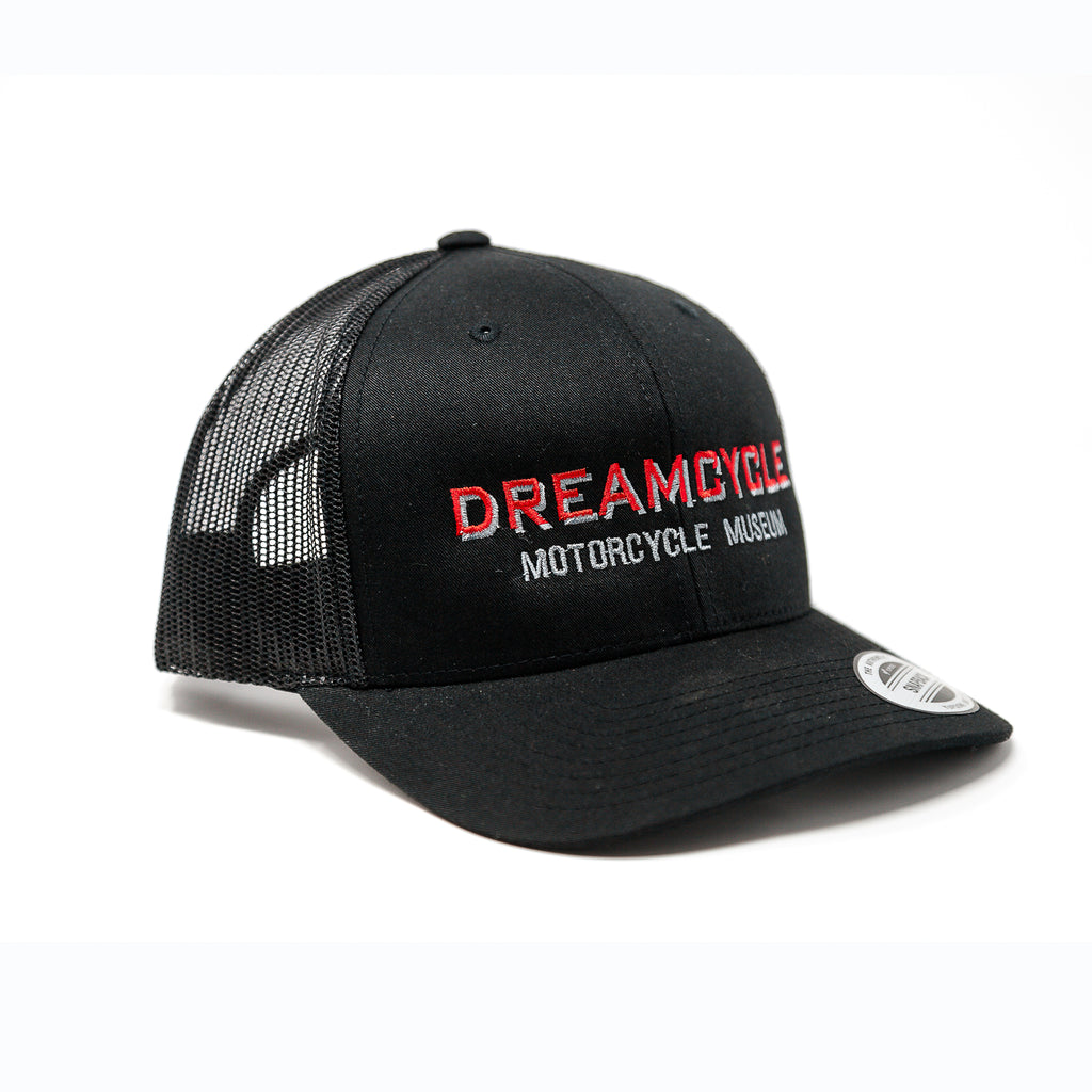 Dreamcycle Motorcycle Museum |  Black dreamcycle trucker hat on white background.