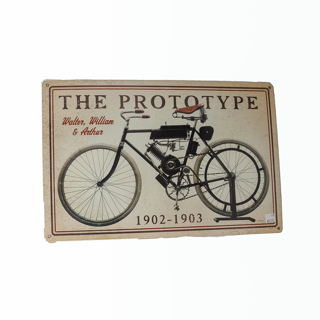 Dreamcycle Motorcycle Museum |  The Prototype metal sign on white background.