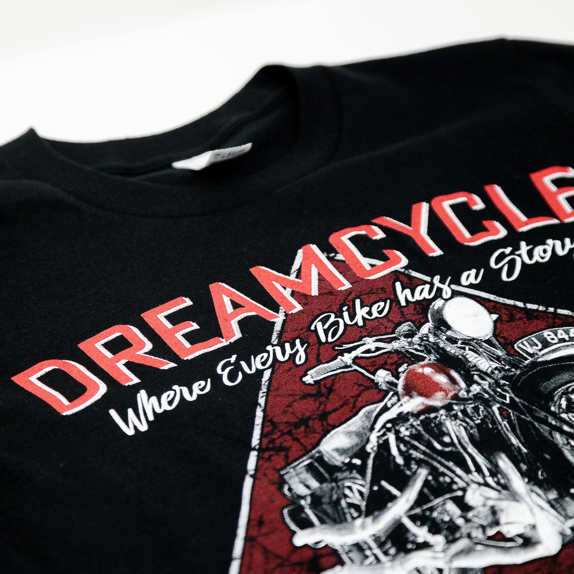 "Dreamcycle Motorcycle Museum |  Detail photo of a tshirt that says ""dreamcycle"" with a large motorcycle on the front."