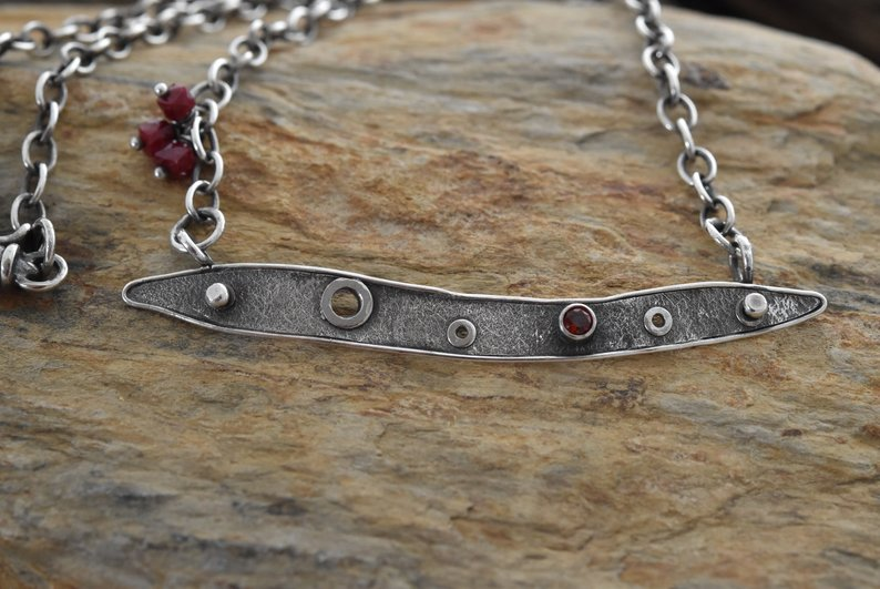 Planet Dot Jewelry Textured Sterling Silver Tab Necklace with Rivets, Deep Red Garnet and a Trio of Cube Rubies