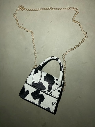 Mini crossbody leather purse with handle, cow print design with gold chain