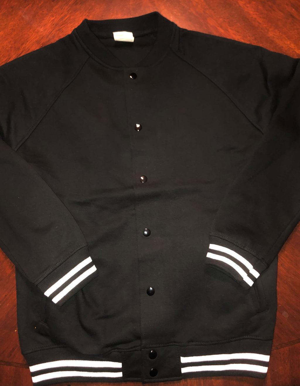 Black Unisex button up varsity sweater (print in the back)
