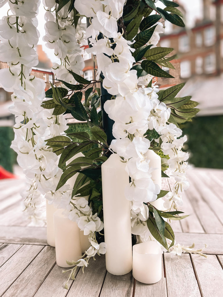 White wisteria flowers and luxury greenery garland for white summer office corporate party.