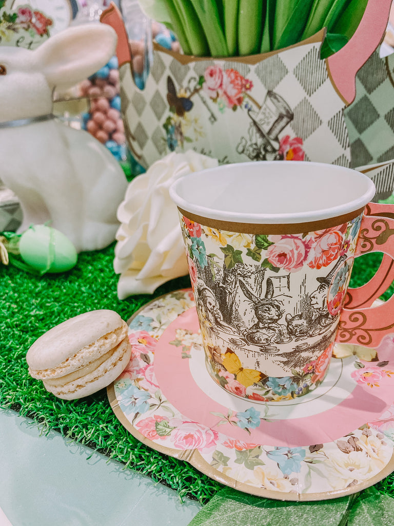Themed Alice in wonderland mad haters tea party kids birthday tableware and cutlery decorations.