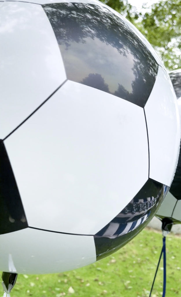 Football themed Chelsea kids birthday party balloon decorations. Soccer football foil orb balloon inflated.