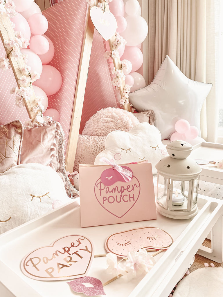 Personalised bespoke pink spa themed sleepover slumber party favours party bag refilled with spa themed manicure tools and other beauty items. Spa themed girls slumber party teepee, tray table, balloons and decorations.