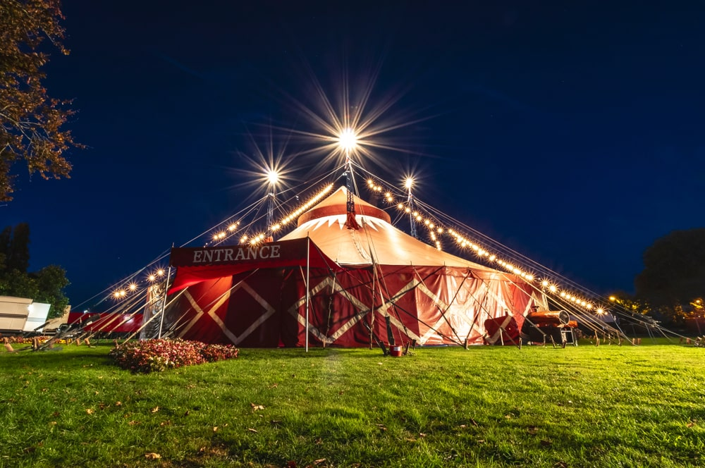 Big-top carnival circus themed tent venue hire for circus the greatest showman dumbo birthday party celebrations. London Events Atelier