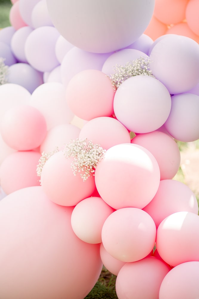 Pink purple and cream white balloon garland for baby shower and girls birthday balloons party decorations.