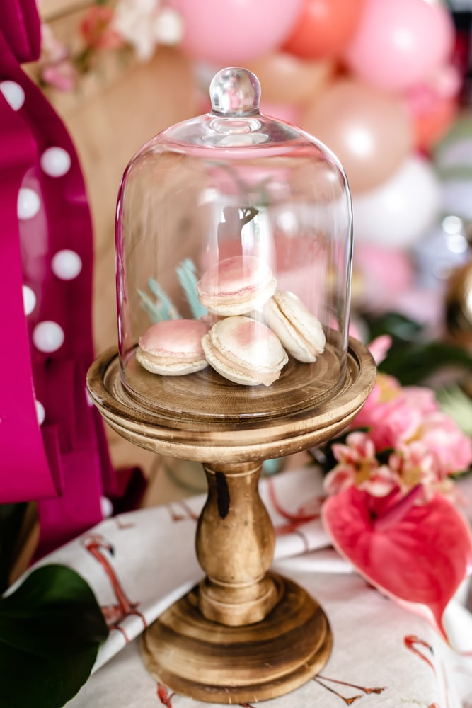 Flamingo party dessert table decorations, pink macaroons in beautiful gold dessert platter.