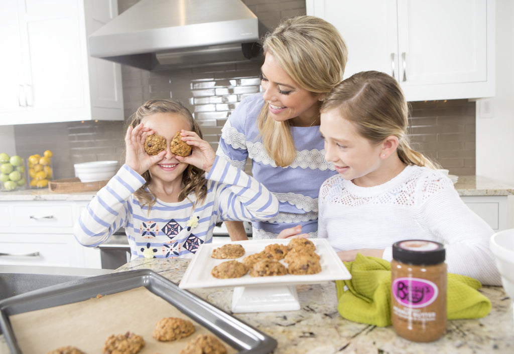 Betsy Opyt, the 2015 Florida Young Mother of the Year, baking peanut butter cookies with her kids on Mother's Day