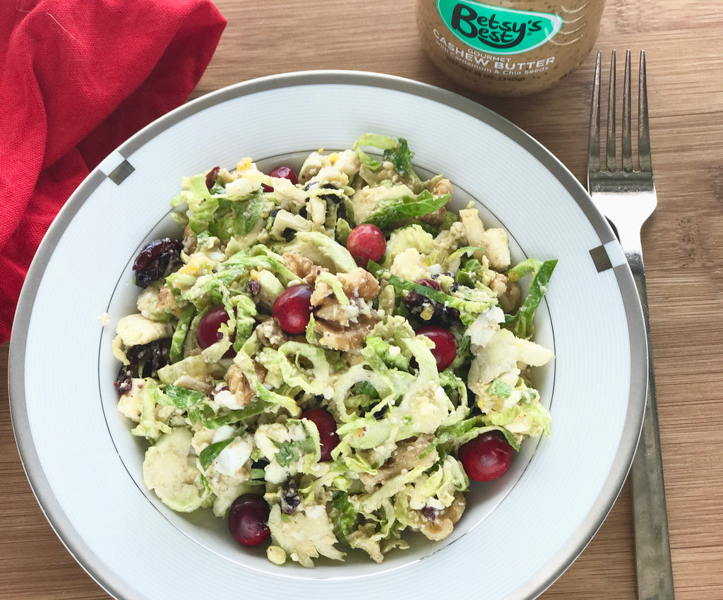 A Brussel sprout chopped salad featuring a savory gourmet cashew butter dressing
