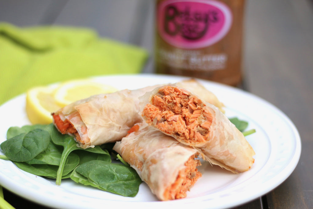A delicious recipe for salmon rolls with a Thai peanut sauce that features Betsy's Best Gourmet Peanut Butter