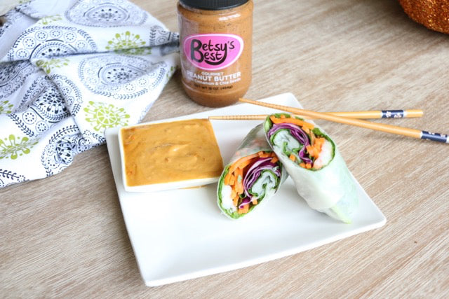A spring roll with Betsy's Best Gourmet Peanut Butter sauce recipe