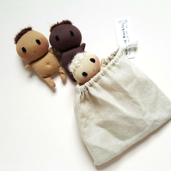 Set of three tiny babies in a bag.