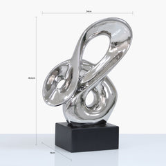 Silver Abstract Sculpture On Black Stand