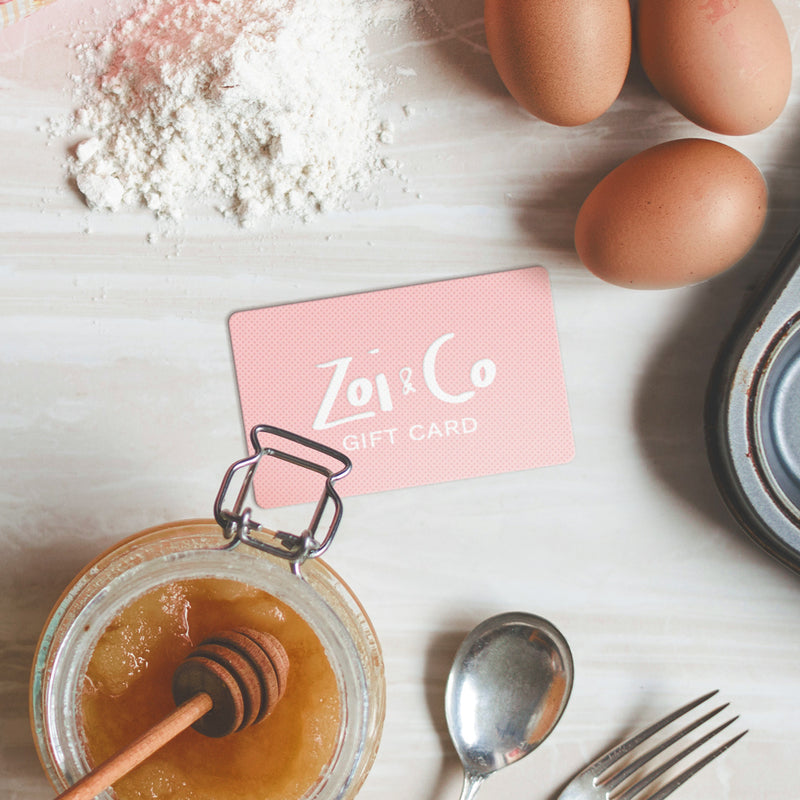 Zoi&Co gift card on a table next to backing supplies