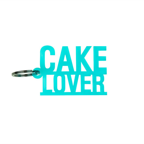 "Frosted ice blue ""Cake Lover"" keychain."