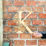 Floral Monogram Wood in front of brick wall - Sign - Zoi&Co