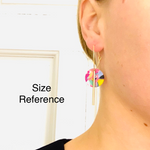 Model shot with multi-colored hoop earrings with gold accessories for size reference