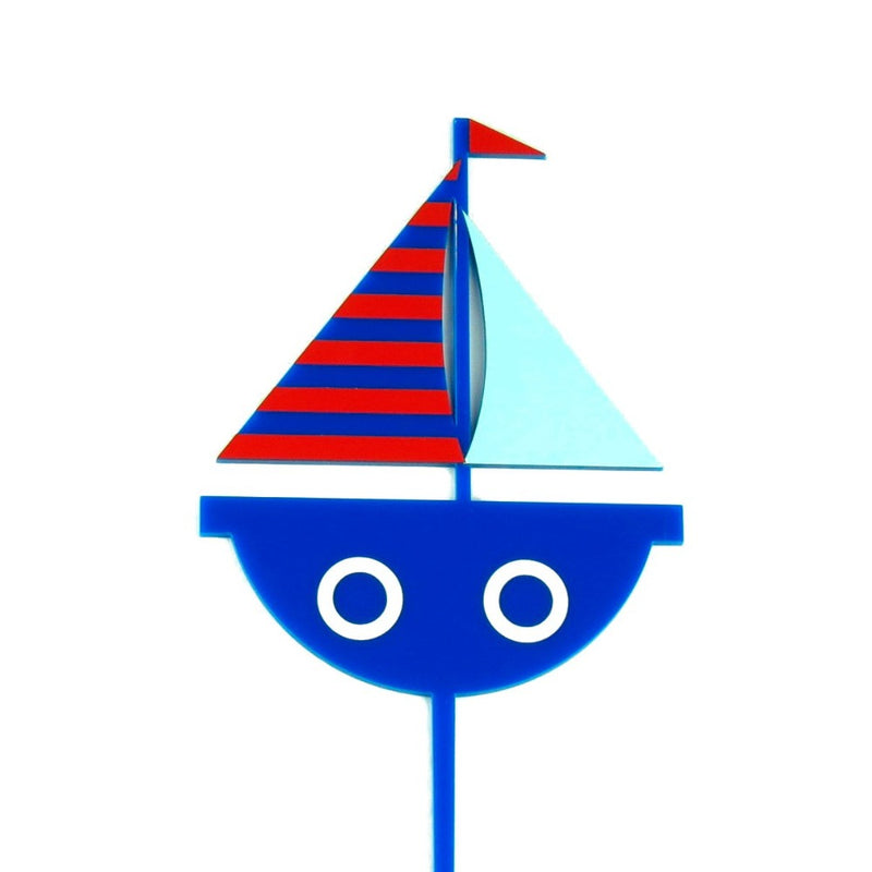Blue acrylic cartoon sail boat cake topper with white and red details